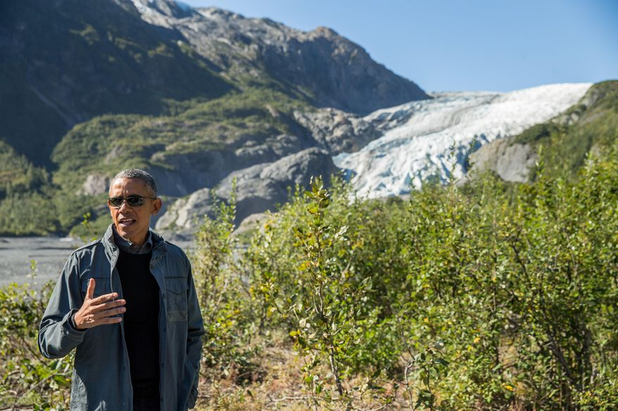 President Barack Obama speaks to members of the media while on a hike to the Exit Glacier in Seward, Alaska, on Sept. 1, 2015, which according to National Park Service research, has retreated approximately 1.25 miles over the past 200 years. (Associated Press) **FILE**
