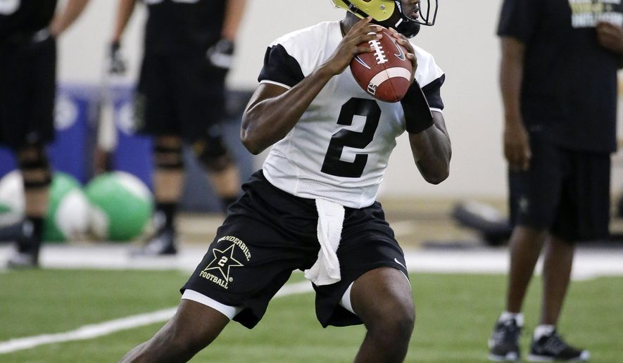 FILE - In this Aug. 6, 2015, file photo, Vanderbilt quarterback Johnny McCrary looks to pass during NCAA college football practice in Nashville, Tenn. The Commodores are keeping their starting quarterback a secret until the first series of their opener Thursday night against Western Kentucky. (AP Photo/Mark Humphrey, File)