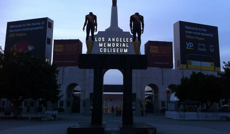 This photo taken Nov. 29, 2014, shows the facade of the Los Angeles Memorial Coliseum in Los Angeles. The U.S. Olympic Committee on Tuesday, Sept. 1, 2015, named Los Angeles as its candidate for the 2024 Games, replacing Boston's soured bid and marking a comeback for LA's dream of becoming a three-time host of the global sports competition. (AP Photo/John Antzczak)