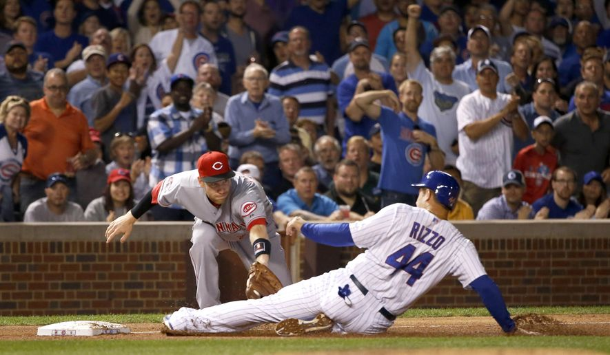 Cincinnati Reds third baseman Todd Frazier tags out Anthony Rizzo at third as Rizzo tries to advance to third off a hit by Kris Bryant during the fifth inning of a baseball game Monday, Aug. 31, 2015, in Chicago. (AP Photo/Charles Rex Arbogast)