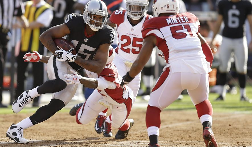 Oakland Raiders wide receiver Michael Crabtree (15) is tackled by Arizona Cardinals defensive back Tony Jefferson, bottom, while under pressure from cornerback Jerraud Powers (25) and linebacker Kevin Minter (51) during the first half of an NFL preseason football game in Oakland, Calif., Sunday, Aug. 30, 2015. (AP Photo/Ben Margot)