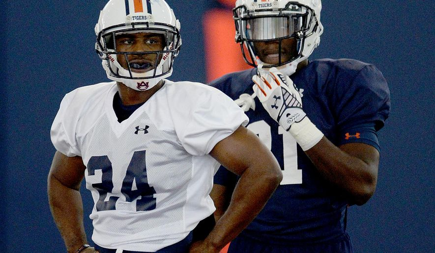 In this photo taken Friday, Aug. 7, 2015, Auburn defensive back Blake Countess (24) and running back Kerryon Johnson (21) attends drills during NCAA college football practice at the Auburn Athletic Complex in Auburn, Ala. (Julie Bennett/AL.com via AP) MAGAZINES OUT; MANDATORY CREDIT