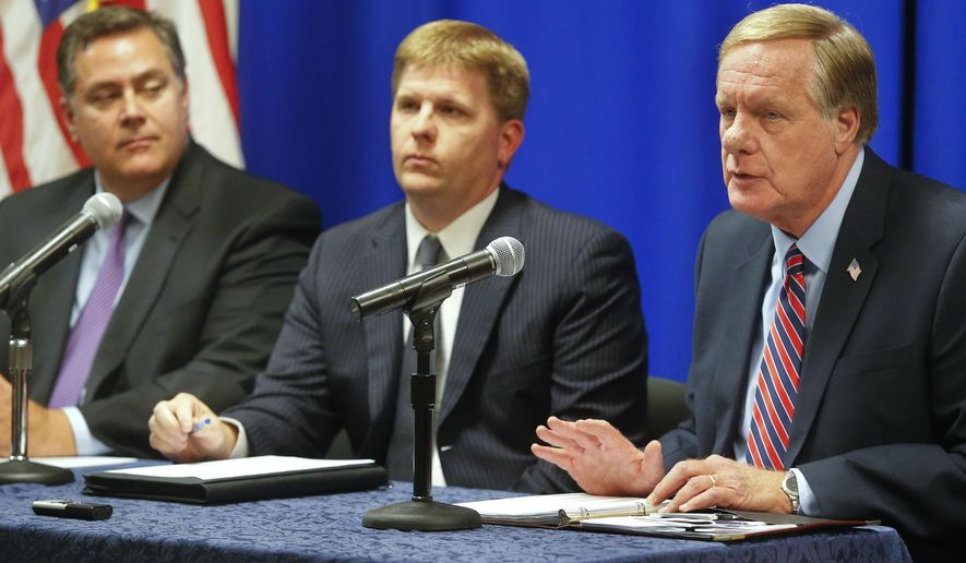 Secretary of the Kansas Department of Revenue Nick Jordan, right, and the governor's budget director Shawn Sullivan, center, and Kansas Department of Commerce's interim secretary Mike Copland, speak during a news conference at the Kansas statehouse in Topeka, Kan., Tuesday Sept. 1, 2015. Kansas collected $30 million less in taxes than anticipated last month, though officials said Tuesday that larger-than-expected income tax refunds were most of the reason. (Chris Neal/The Topeka Capital-Journal via AP)