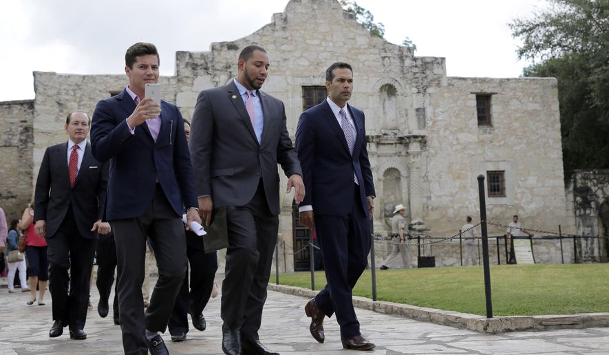 Texas Land Commissioner George P. Bush, right, arrives for a news conference to celebrate the $31.5 million the General Land Office received for the preservation and development of the Alamo, Wednesday, Sept. 2, 2015, in San Antonio. (AP Photo/Eric Gay)