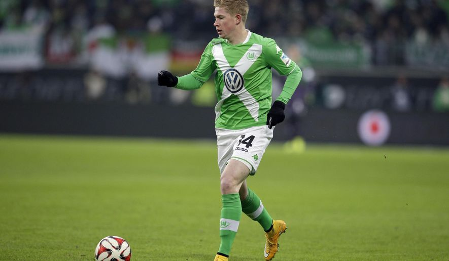 In this Nov. 30, 2014 photo Wolfsburg's Kevin De Bruyne from Belgium plays the ball during the German Bundesliga soccer match between VfL Wolfsburg and Borussia Moenchengladbach at the Volkswagen Arena stadium in Wolfsburg, Germany. Kevin de Bruyne joined Manchester City from Wolfsburg for a reported fee of 58 million pounds ( US $89 million) on Sunday Aug. 30, 2015, making the Belgium midfielder the second most expensive player in the history of English football.  (AP Photo/Michael Sohn)