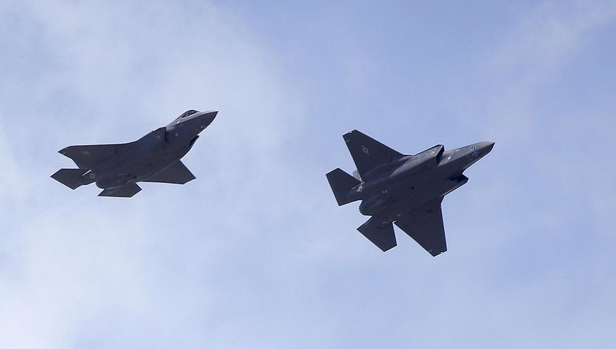 Two F-35 jets arrive at it's new operational base Wednesday, Sept. 2, 2015, at Hill Air Force Base, in northern Utah. Two F-35 jets touched down Wednesday afternoon at the base, about 20 miles north of Salt Lake City. A total of 72 of the fighter jets and their pilots will be permanently based in Utah. (AP Photo/Rick Bowmer)