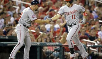 Washington Nationals' Ryan Zimmerman, right, is congratulated by third base coach Bob Henley while rounding the bases after hitting a solo home run during the third inning of a baseball game against the St. Louis Cardinals Tuesday, Sept. 1, 2015, in St. Louis. (AP Photo/Jeff Roberson)