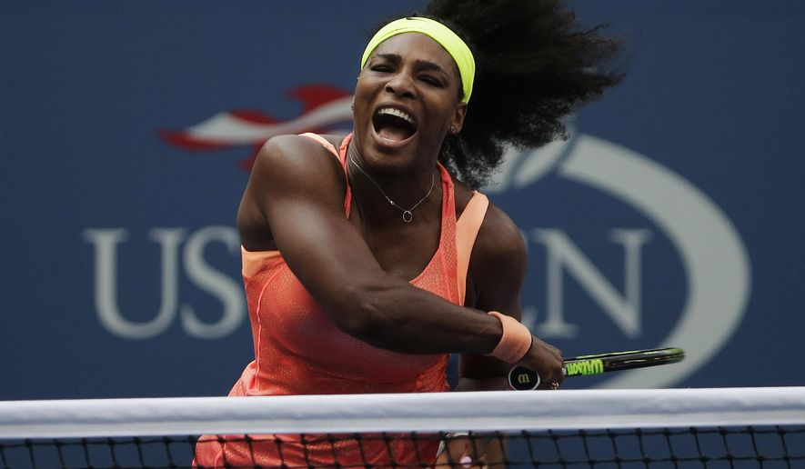 Serena Williams follows through as she returns a shot to Kiki Bertens, of the Netherlands, during the second round of the U.S. Open tennis tournament, Wednesday, Sept. 2, 2015, in New York. (AP Photo/Charles Krupa)