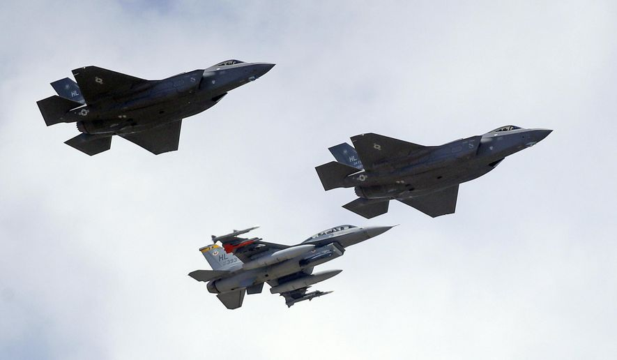 An F-16, below, escorts two F-35 jets, above, after arriving at it new operational base Wednesday, Sept. 2, 2015, at Hill Air Force Base, in northern Utah. Two F-35 jets touched down Wednesday afternoon at the base, about 20 miles north of Salt Lake City. A total of 72 of the fighter jets and their pilots will be permanently based in Utah. The Air Force says the F-35s are replacing the older F-16 with greater speed and combat range and lower maintenance costs due to a computerized self-test system.(AP Photo/Rick Bowmer)