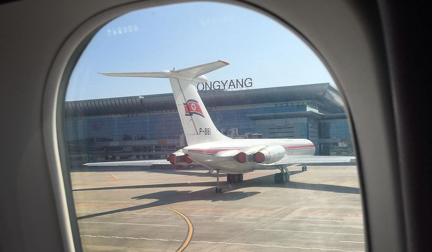In this Saturday, June 27, 2015, photo, an Air Koryo plane sits on the tarmac in front of the new Pyongyang International Airport terminal building, in Pyongyang, North Korea. Air Koryo is the only carrier to have been awarded just one star in rankings released recently by the UK-based SkyTrax consultancy agency. (AP Photo/Wong Maye-E)