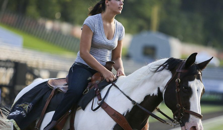 Katie Stewart, president of Western Michigan University's award-winning equestrian team, works with Triumph at Waldo Stadium in Kalamazoo, Mich., on Tuesday, Sept. 1, 2015.  Stewart will take the place of former rider Alyssa Davidson, who graduated in the spring. (Crystal Vander Weit/Kalamazoo Gazette-MLive Media Group via AP) ALL LOCAL TELEVISION OUT; LOCAL TELEVISION INTERNET OUT; MANDATORY CREDIT