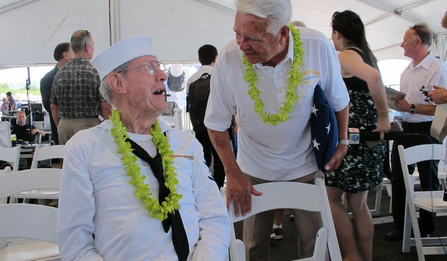 World War II USS Missouri shipmates Ray Morse, left, of Huntington, W.Va. and Donald Fosburg of Whittier, Calif. catch up after a ceremony marking the 70th anniversary of the end of World War II, Wednesday, Sept. 2, 2015 in Pearl Harbor, Hawaii. The veterans gathered on board the decomissioned battleship Missouri, the same ship Japanese Foreign Minister Mamoru Shigemitsu and Army Gen. Yoshijiro Umezu boarded in Tokyo Bay on Sept. 2, 1945 to sign documents to formally surrender. (AP Photo/Audrey McAvoy)