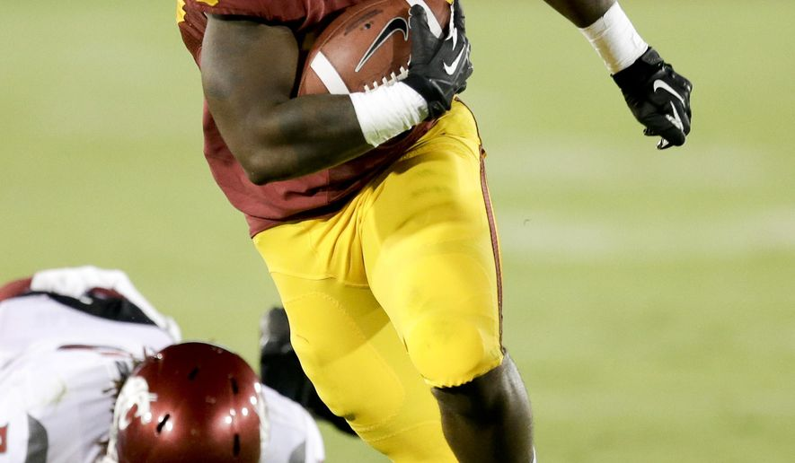 FILE - In this Sept. 7, 2013, file photo, Southern California running back Tre Madden runs against Washington State during an NCAA college football game in Los Angeles. Madden never lost faith in his ability and durability while missing two of the last three seasons at Southern California due to injuries. (AP Photo/Chris Carlson, file)