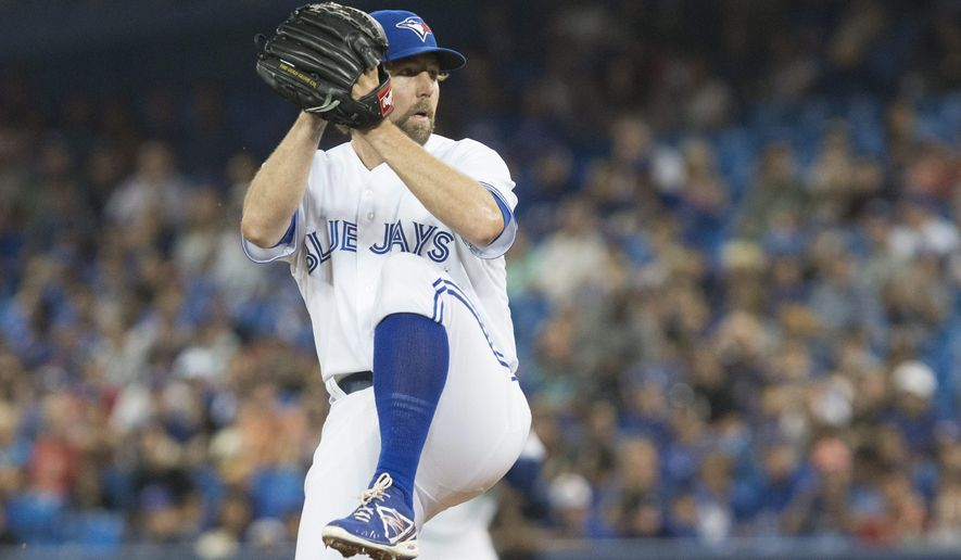 Toronto Blue Jays starting pitcher R.A. Dickey works against yjr Cleveland Indians during the firs inning of a baseball game Wednesday, Sept. 2, 2015, in Toronto. (Chris Young/The Canadian Press via AP)