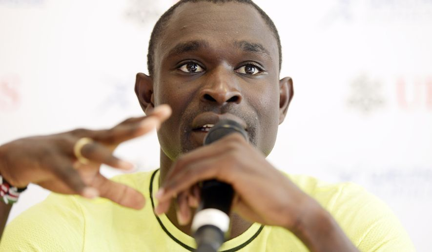Kenyan middle distance runner David Rudisha, answers journalists questions during a press conference in  Glattbrugg near Zurich, Switzerland, Wednesday, Sept. 2, 2015. David Rudisha  will compete i Thursday at  Weltklasse IAAF Diamond League international athletics meeting in the Letzigrund stadium in Zurich Thursday..  (Walter Bieri/Keystone via AP)