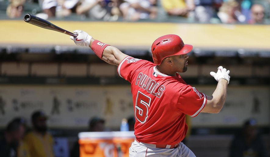 Los Angeles Angels' Albert Pujols hits a two-run home run off Oakland Athletics starting pitcher Sonny Gray in the second inning of a baseball game, Wednesday, Sept. 2, 2015, in Oakland, Calif. (AP Photo/Eric Risberg)