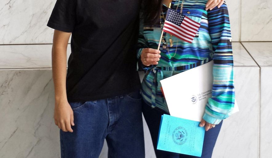 In this April 10, 2015 photo provided by the Benavides family, Daniel Benavides poses with his mother, Maria Luisa Benavides, during a citizenship ceremony in Las Vegas. Daniel Benavides died Tuesday, Sept. 1, 2015, after being struck by a vehicle while crossing a North Las Vegas, Nev., street not far from his high school. Police say speed may be a factor but the cause and manner of his death were still being investigated. Police say the 25-year-old driver of the Dodge SUV remained at the scene after the crash.(Benavides Family via AP)