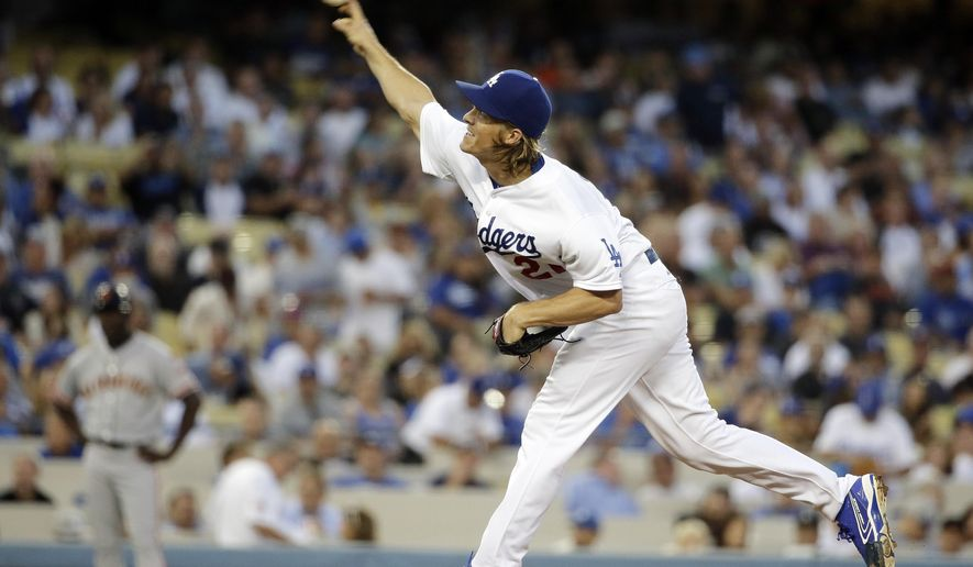 Los Angeles Dodgers starting pitcher Zack Greinke throws to the San Francisco Giants during the first inning of a baseball game in Los Angeles, Tuesday, Sept. 1, 2015. (AP Photo/Chris Carlson)