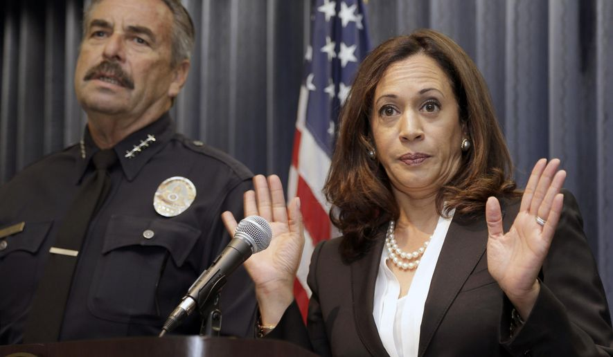California Attorney General Kamala Harris, righ, joined by Los Angeles Police Chief Charlie Beck, speaks during a news conference to announce a criminal justice open database in Los Angeles, Wednesday, Sept. 2, 2015. The California Department of Justice  unveiled a state-run website to provide data on law enforcement's interactions with the public. The database is the culmination of months of work aimed at improving transparency and government accountability after incidents sparked debate across the country on police practices over the last year. (AP Photo/Nick Ut)