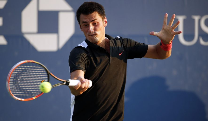 Bernard Tomic, of Australia, returns against Damir Dzumhur, of Bosnia and Herzegovina, during the first round of the U.S. Open tennis tournament, Tuesday, Sept. 1, 2015, in New York. (AP Photo/Julio Cortez)