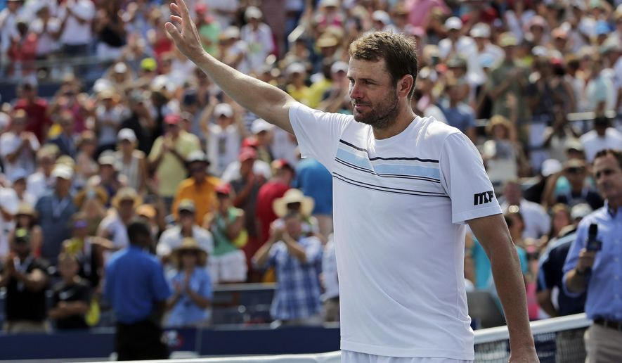 Mardy Fish waves to the crowd as he walks off the court after losing to Feliciano Lopez, of Spain, during the second round of the U.S. Open tennis tournament, Wednesday, Sept. 2, 2015, in New York. (AP Photo/Frank Franklin II)