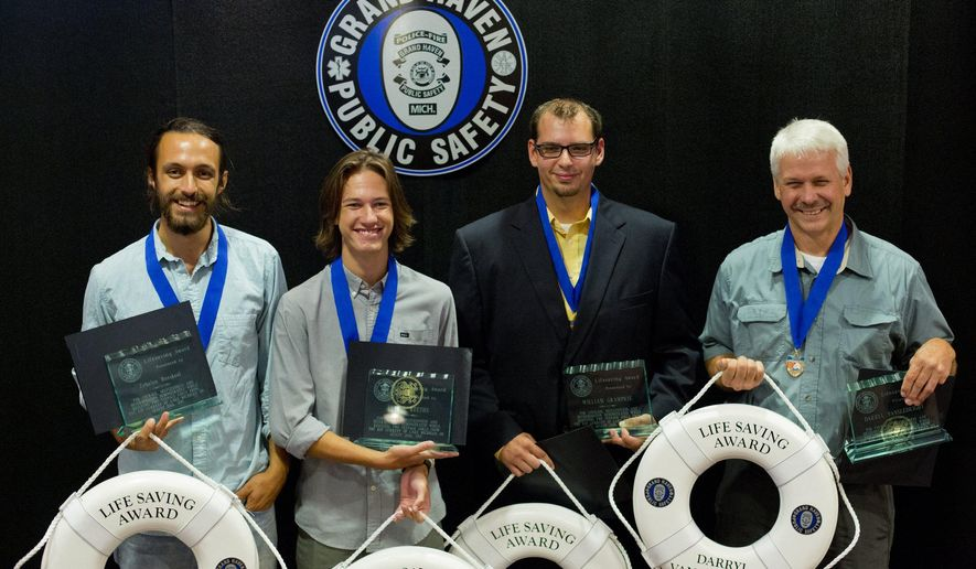 Zebulon Boeskool, Trevor Reeths, William Gramprie, and Darryl Vansledright pose for a photo with their awards after Lifesaving Awards Ceremony at the Community Center in Grand Haven, Mich. on Wednesday, Sept.   2, 2015. The five  were honored for their courage to rescue two teenage girls who almost drowned on Aug. 20, 2015 at Grand Haven State Park. Doug Jedle who was not pictured could not make it to the event.  (Joel Bissell/Muskegon Chronicle via AP) ALL LOCAL TELEVISION OUT; LOCAL TELEVISION INTERNET OUT; MANDATORY CREDIT