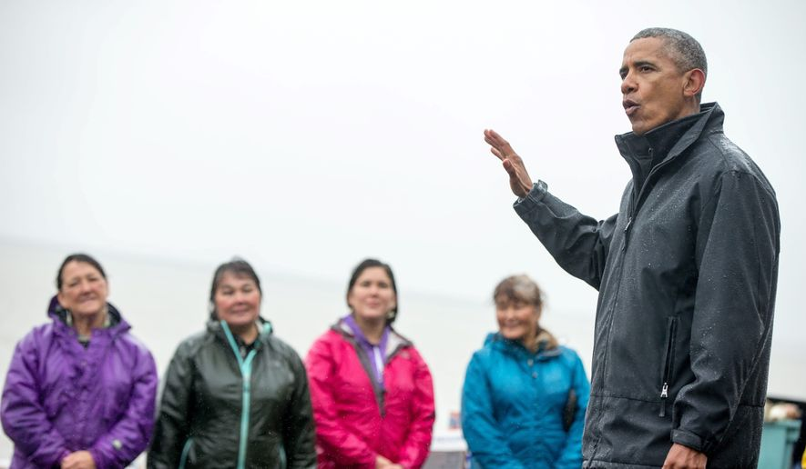 """President Obama, accompanied by local fishermen, speaks to members of the media on Kanakanak Beach on Wednesday in Dillingham, Alaska. On an historic three-day trip to Alaska, Mr. Obama declared """"we're not acting fast enough"""" to save the planet from rising sea levels, warmer temperatures and other climate-change consequences. (associated press)"""