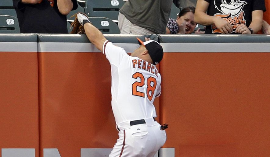 Baltimore Orioles left fielder Steve Pearce catches a fly ball by Tampa Bay Rays' Brandon Guyer during the first inning of a baseball game, Wednesday, Sept. 2, 2015, in Baltimore. (AP Photo/Patrick Semansky)