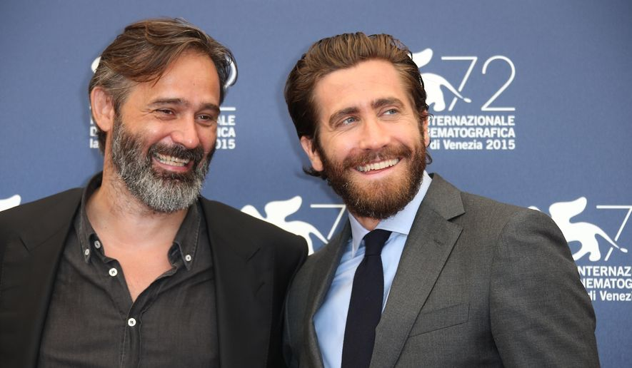 Baltasar Kormakur and Jake Gyllenhaal pose for photographers at the photo call for the film Everest at the 72nd edition of the Venice Film Festival in Venice, Italy, Wednesday, Sept. 2, 2015. The 72nd edition of the festival runs until Sept. 12. (Photo by Joel Ryan/Invision/AP)