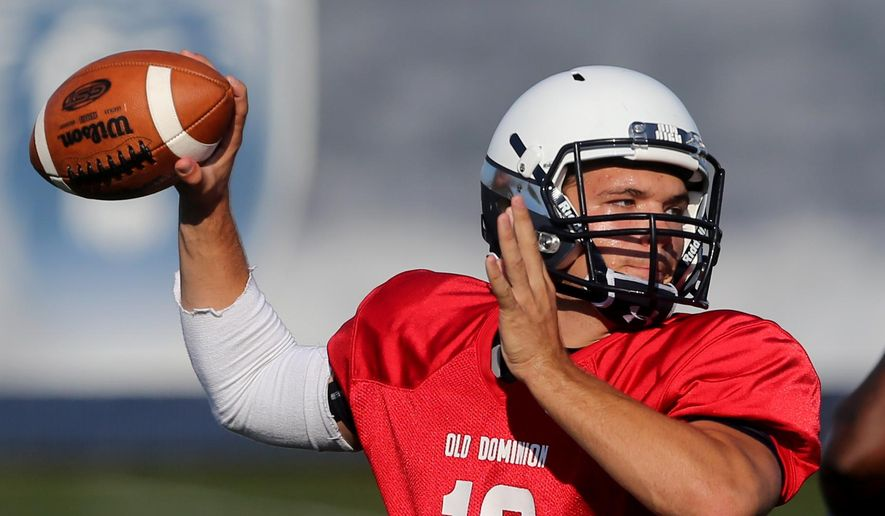 In this photo taken on Monday, Aug. 29, 2015, Old Dominion University quarterback Shuler Bentley throws a pass during a practice, in Norfolk, Va. Bentley spent last season watching, and learning from, Taylor Heinicke at Old Dominion. Now, with the prolific Heinicke trying to make the NFL's Minnesota Vikings, Bentley is charged with replacing him.  (AP Photo/Jason Hirschfeld)