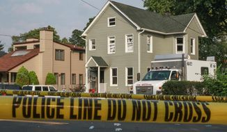 Police tape cordons off the area as officials investigate a house fire, Wednesday, Sept. 2, 2015, in Long Branch, N.J. Authorities say the house fire reported late Tuesday night at the Jersey shore, in which four people died, does not appear accidental and could possibly be a murder-suicide. (Tom Spader/The Asbury Park Press via AP)  NO SALES; MANDATORY CREDIT
