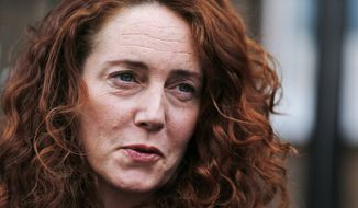 In this Thursday, June 26, 2014, file photo, Rebekah Brooks, former News International chief executive, talks to members of the media in central London. News Corp, Rupert Murdoch's print empire, on Wednesday, Sept. 2, 2015 said that Brooks will be CEO of News Corp UK, returning to a role she left in 2011 amid the hacking scandal at the company's now defunct News of the World paper. (AP Photo/Lefteris Pitarakis, File)
