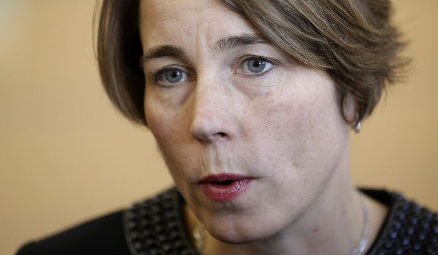 FILE - In this Jan. 22, 2015, file photo, Massachusetts Attorney General Maura Healey speaks with members of the media after testifying before the Massachusetts Gaming Commission in Boston. Healey is scheduled to issue rulings Wednesday, Sept. 2, 2015, on the constitutionality of more than 30 initiative petitions. (AP Photo/Steven Senne, File)