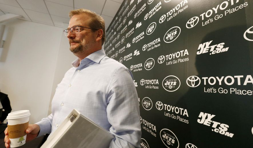 FILE - In this April 24, 2015, file photo, New York Jets general manager Mike Maccagnan speaks to reporters after an NFL football news conference in Florham Park, N.J. The 48-year-old Maccagnan is the man charged with returning the franchise to respectability after owner Woody Johnson made sweeping changes following a fourth straight season without making the playoffs.  (AP Photo/Julio Cortez, File)