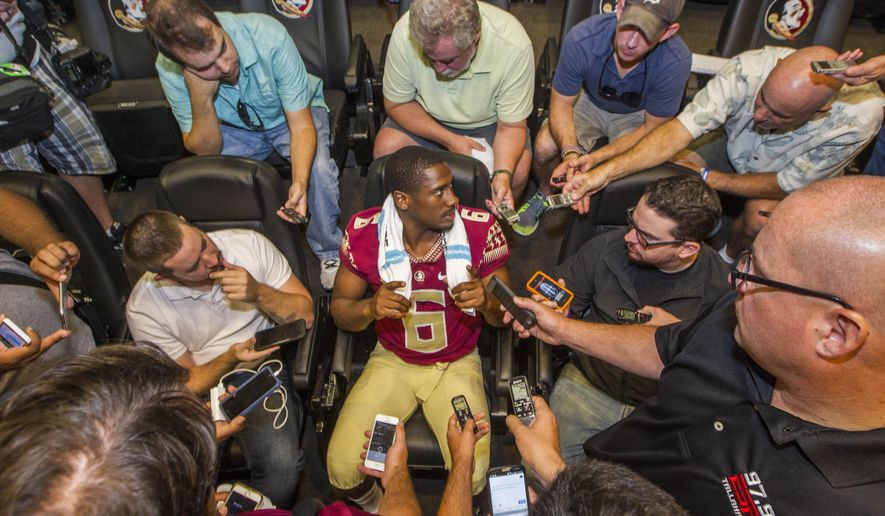 FILE - In this Aug. 9, 2015, file photo, Florida State quarterback Everett Golson, center, talks during NCAA college football media day in Tallahassee, Fla. Everett Golson and Vernon Adams were the biggest names on the graduate transfer market this offseason and both won their respective jobs at Florida State and Oregon. (AP Photo/Mark Wallheiser, File)