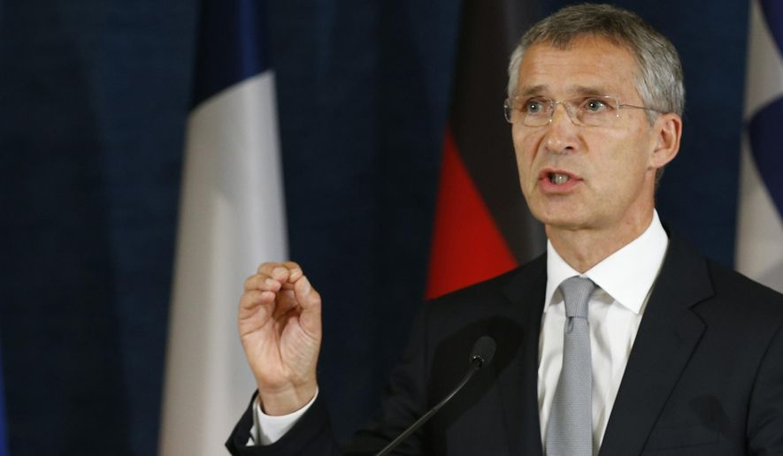 NATO Secretary General Jens Stoltenberg, left, addresses the media at a news conference at the NATO Force Integration Unit Headquarters in Vilnius, Lithuania, Thursday, Sept. 3, 2015. NATO Force Integration Units are small command and control headquarters whose key mission is to facilitate the rapid deployment of the NATO Very High Readiness Joint Task Force  and additional rapid response elements into the region if needed.  (AP Photo/Mindaugas Kulbis)