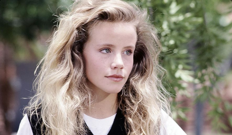 "This undated file photo provided by Disney shows actress Amanda Peterson in ""Can't Buy Me Love."" The death of Peterson was the result of an accidental morphine overdose. The autopsy and toxicology report released Wednesday, Sept. 2, 2015, by the Weld County Coroner's Office concluded that Peterson, 43, ingested a friend's morphine medication for unspecified pain a week before her death. (Copyright Disney via AP, File)"