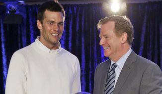 "FILE - In this Feb. 2, 2015, file photo, New England Patriots quarterback Tom Brady poses with NFL Commissioner Rodger Goodell during a news conference after NFL football's Super Bowl XLIX in Phoenix, Ariz. A federal judge deflated ""Deflategate"" Thursday, Sept. 3, 2015, erasing New England quarterback Tom Brady's four-game suspension for a controversy that the NFL claimed threatened football's integrity. U.S. District Judge Richard M. Berman said NFL Commissioner Roger Goodell went too far in affirming punishment of the Super Bowl winning quarterback. (AP Photo/David J. Phillip, File) **FILE**"
