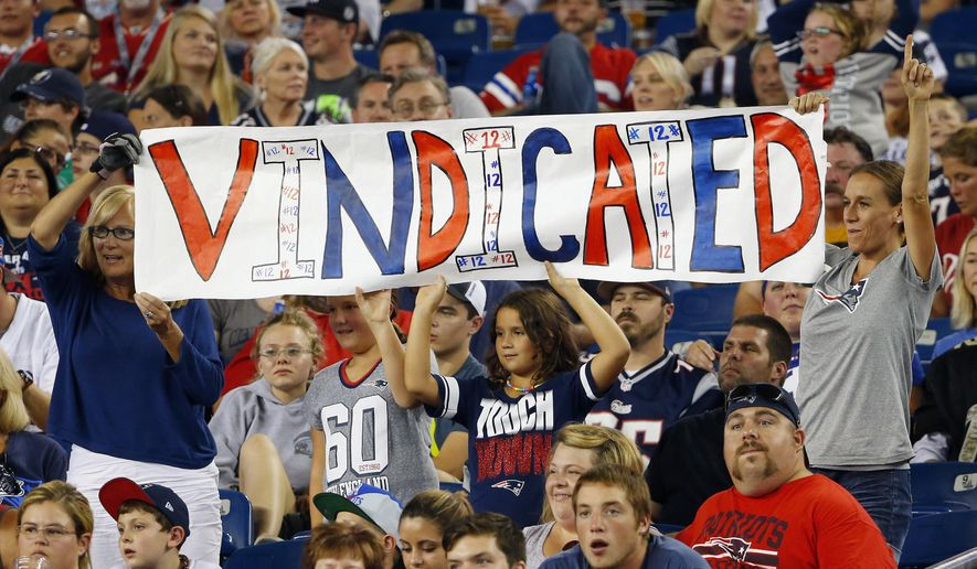 New England Patriots fans hold a sign that refers to Patriots quarterback Tom Brady in the first half of an NFL football game between the Patriots and the New York Giants Thursday, Sept. 3, 2015, in Foxborough, Mass. Federal Judge Richard M. Berman overturned NFL Commissioner Roger Goodell's four-game suspension of Brady Thursday morning. The league said it will appeal the ruling. (AP Photo/Winslow Townson)