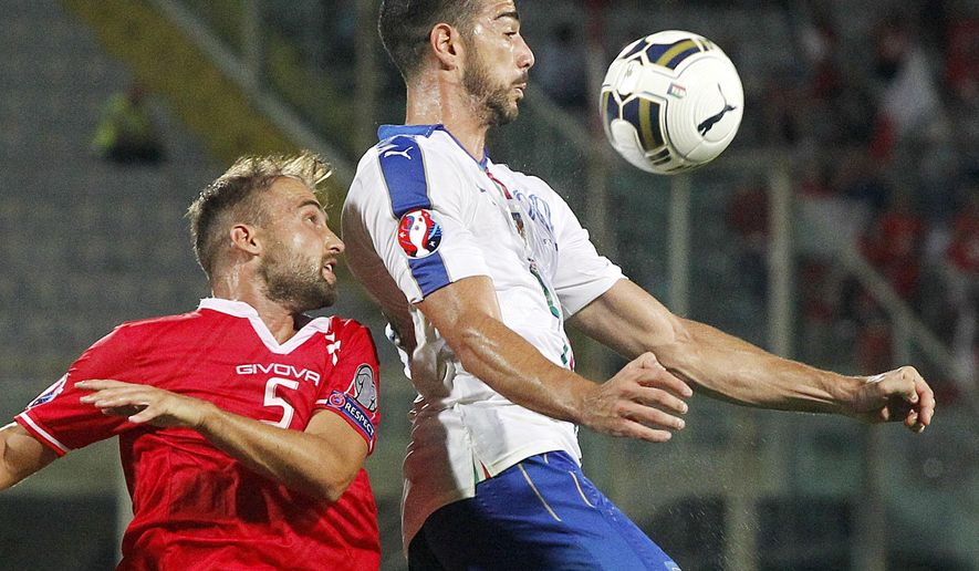 Malta's Andrei Agius, left, and Italy's Graziano Pelle' vie for the ball during the Euro 2016 qualifying match between Italy and Malta at the Artemio Franchi stadium in Florence, Italy, Thursday, Sept. 3, 2015. (AP Photo/Fabrizio Giovannozzi)