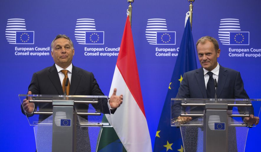 European Council President Donald Tusk, right, and Hungarian Prime Minister Viktor Orban participate in a media conference at the EU Council building in Brussels on Thursday, Sept. 3, 2015. Hungarian Prime Minister Viktor Orban is visiting EU officials on Thursday to discuss the current migration crisis. (AP Photo/Virginia Mayo)