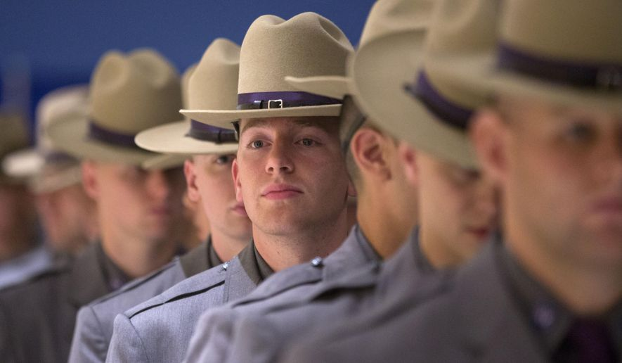 Graduating New York State Police troopers line up before a ceremony at the Empire State Plaza Convention Center on Thursday, Sept. 3, 2015, in Albany, N.Y. New York Gov. Andrew Cuomo told graduates the job of state troopers over the next 20 years will include more emergency responses to major storms, cybersecurity threats, evolving terrorism, emerging diseases and other public safety threats. (AP Photo/Mike Groll)