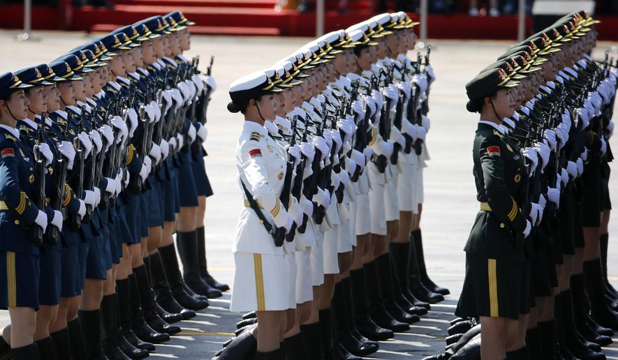 Chinese female military personnel march during a parade commemorating the 70th anniversary of Japan's surrender during World War II held in front of Tiananmen Gate, in Beijing, Thursday, Sept. 3, 2015. The spectacle involved more than 12,000 troops, 500 pieces of military hardware and 200 aircraft of various types, representing what military officials say is the Chinese military's most cutting-edge technology. (AP Photo/Ng Han Guan)