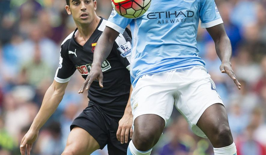 Manchester City's Yaya Toure, right, keeps the ball from Watford's Jose Manuel Jurado during the English Premier League soccer match between Manchester City and Watford at the Etihad Stadium, Manchester, England, Saturday Aug. 29, 2015. (AP Photo/Jon Super)
