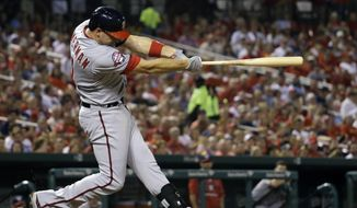 Washington Nationals' Ryan Zimmerman follows through on a solo home run during the fourth inning of a baseball game against the St. Louis Cardinals Wednesday, Sept. 2, 2015, in St. Louis. (AP Photo/Jeff Roberson)