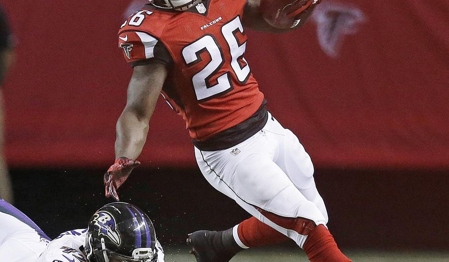 Atlanta Falcons running back Tevin Coleman (26) Baltimore Ravens linebacker Brennen Beyer (45) during the first half of an NFL football preseason game, Thursday, Sept. 3, 2015, in Atlanta. (AP Photo/Brynn Anderson )