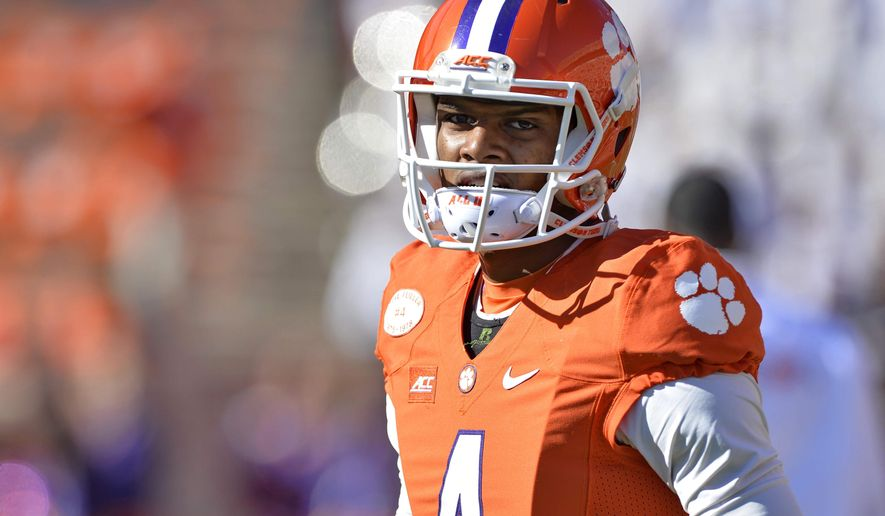 FILE - In this Nov. 29, 2014, file photo, Clemson quarterback Deshaun Watson walks the field during warmups before the start of an NCAA college football game against South Carolina in Clemson, S.C. Watson could be the face of college football this season or the injured star in street clothes on the sideline.  (AP Photo/Richard Shiro, File)
