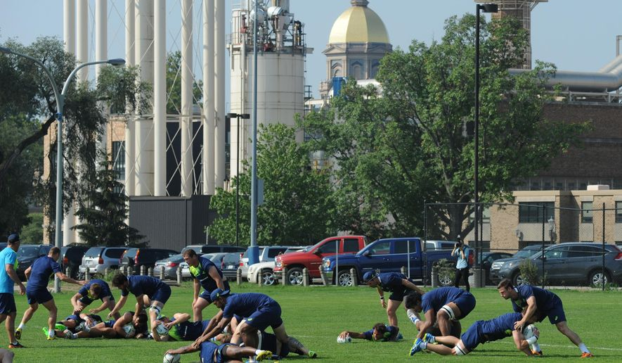The Australian National Rugby team, nicknamed the Wallabies, practice at the University of Notre Dame in South Bend, Ind., Thursday, Sept. 3, 2015. The USA Rugby Eagles and Australia Wallabies play at Soldier Field in Chicago on Saturday, in a final test before both teams depart for the Rugby World Cup in England. In the background is the Notre Dame Administration Building often referred to as the Golden Dome.  (AP Photo/Joe Raymond)