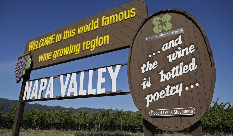 In this photo taken Tuesday, Aug. 25, 2015, a sign welcomes visitors to the Napa Valley in Oakville, Calif. Sunlit hills of lush green vineyards, blue skies, fine red wines, some things about wine country never change. But others do, like where to eat, stay and play. (AP Photo/Eric Risberg)