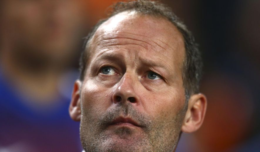 Netherlands' head coach Danny Blind waits for the start of the Euro 2016 qualifying soccer match between Netherlands and Iceland, at the ArenA stadium, in Amsterdam, Netherlands, Thursday, Sept. 3, 2015. (AP Photo/Peter Dejong)